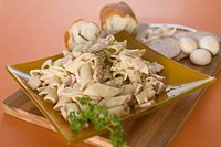 Close_up of a plate of pasta with breads
