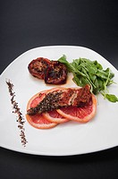 Close_up of pepper coated chops with grapefruit