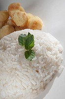 White rice with fritters and basil leaves