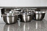 Stainless steel bowls on a kitchen counter