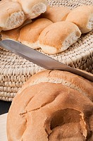 Close_up of loaves of bread with a knife