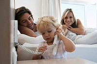 Baby 12_24 months on the phone in bedroom, young parents watching