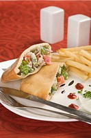 Stuffed pita sandwiches served with French fries