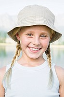 Girl 8_13 blond, looking at camera wearing hat, outdoors