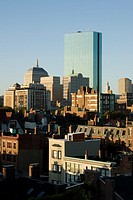 sun rise shines on downtown Boston skyline with Hancock Tower prominent