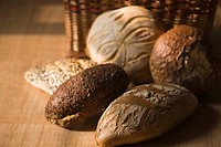 Close_up of breads with wicker basket