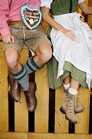 Detail of young couple in Bavarian costume at Oktoberfest, Munich, Germany
