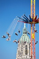 Steeple of St Paul's church with carousel, Oktoberfest, Munich, Germany