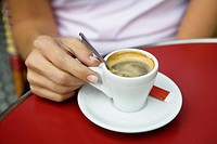 Close up of young woman sitting at cafe table, outdoors, Paris, France (thumbnail)