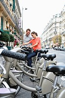 Young couple renting bikes, Paris, France