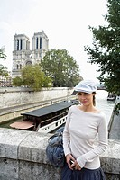 Young woman in front of Notre Dame Cathedral, Paris, France