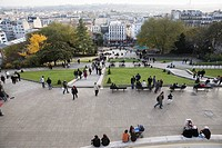 Tourists in gardens below Sacre Coeur, Montmartre, Paris, France