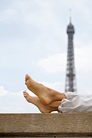 Close up of woman´s legs with Eiffel tower in background, Paris, France