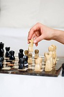 Close up of person playing chess