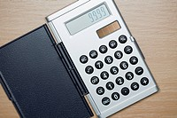 Close up of silver calculator from above