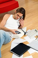 Man on phone doing home finances