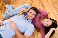 Young couple lying on floor