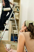 Young couple decorating new home