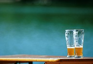 Two wheat beer glasses on table in beer garden, Munich, Germany