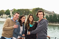 Group of four young people standing by River Seine, Paris, France