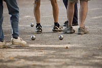 People playing boules, close_up of feet, Munich, Germany