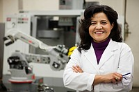 Hispanic woman in robotics laboratory