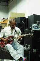 African man playing electric guitar