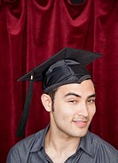 Mixed race man wearing mortarboard