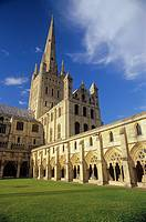 UK, England, Norfolk, Norwich Cathedral, primarily built 1096-1145: cloister lawn or 'garth', cloister, south transept, crossing tower and spire, both...