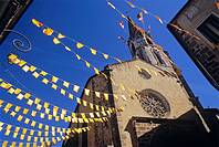 France, Poitou-Charente region, Vienne River valley, Confolen, old town, church tower with festive flags