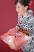 Woman in Kimono Holding Furoshiki