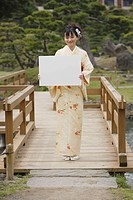 Japanese Woman Holding White Board