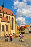 People in front of Church of St Egidius central Bardejov eastern Slovakia EU
