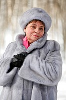 Middle aged woman in fur at winter, Russia