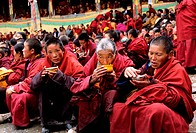 China, Eastern Tibet, monks having their meal at Katok monastery