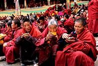 China, Eastern Tibet, monks having their meal at Katok monastery