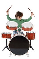 Beautiful boy playing the drums