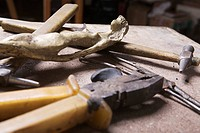 wooden statue and tools in workshop