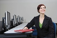 Cheerful Businesswoman Sitting at Desk