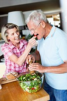 Senior Couple Preparing Salad