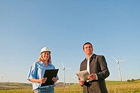 engineer and businessman in wind farm