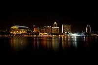 Night shot of Singapore skyline with Esplanade and Singapore Flyer