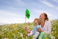 mother and son with green toy windmill