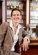 business woman having coffee at bar