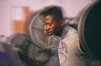 African man weight lifting with barbell