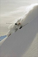 Skier turning in deep powder snow.