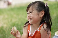 Smiling girl holds a bread