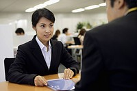A woman having a professional meeting in the office