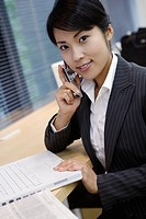 A businesswoman conversing on the mobile phone