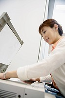 A woman operating a Xerox machine